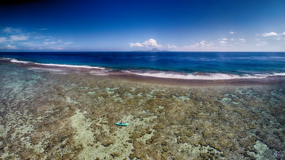 Canoe on reef barrier, Tahaa, Bora Bora, French Polynesia