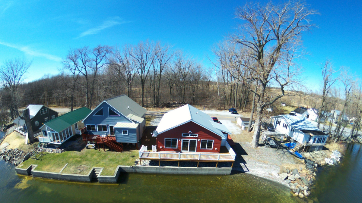 Cottages on shore of lake champlain dronestagram for Lake champlain cabins and cottages