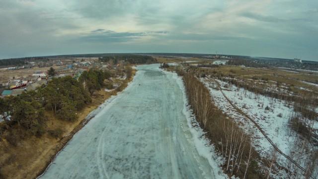 """The village of """"Fabrika"""". River """"Mologa"""". Bridge."""