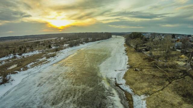 "Sunset. The river ""Mologa""."