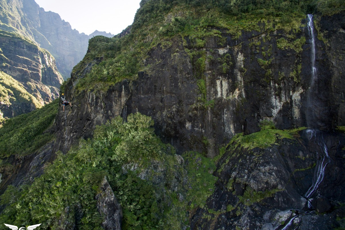 Climbing Mountain next to waterfall, Cilaos, Reunion