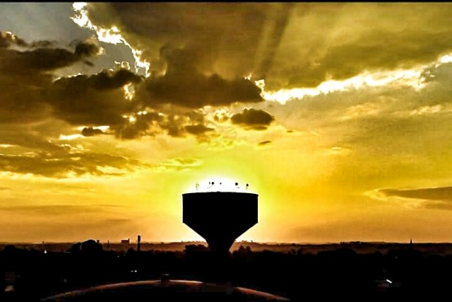 Sunset behind water tower