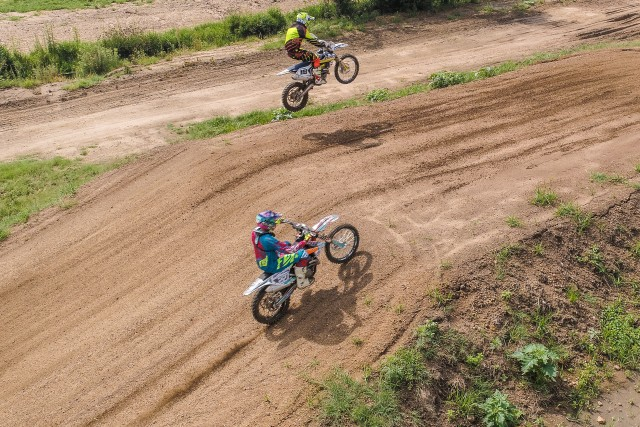 Bikes jumping at Terra Topia motorcross track