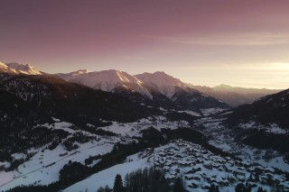 Sunset and Mountains over the Village of Bellwad Switzerland