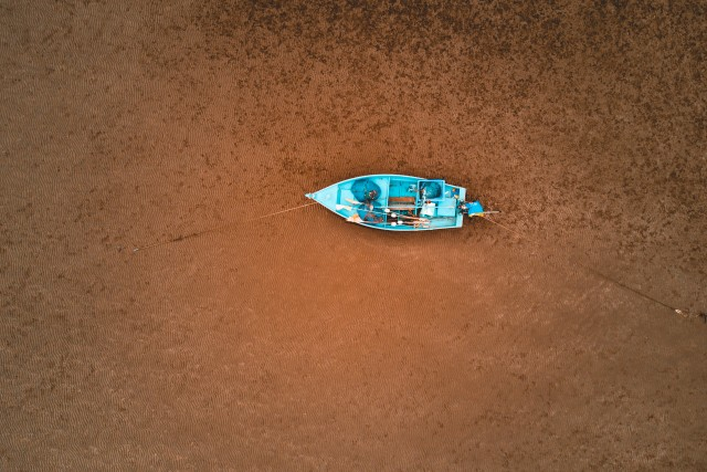 Low Tide Fishing Boat On Sand – Hua Hin – Thailand