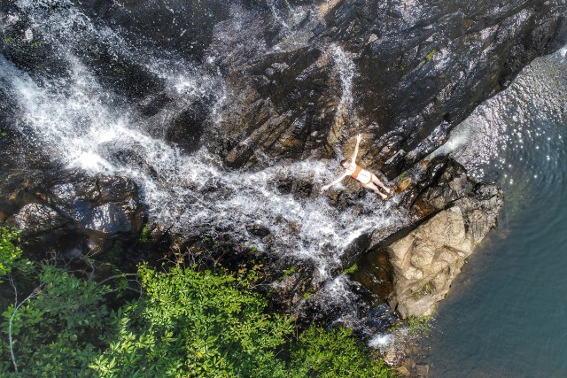 Girl under the waterfall