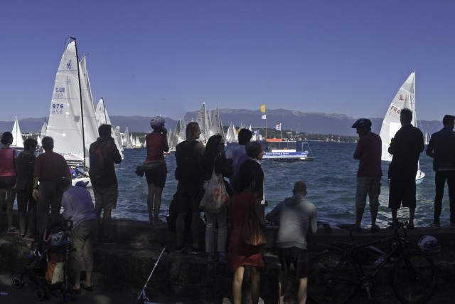crowds watching a sailing race on Lake Geneva