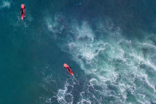Surfing in pacific ocean