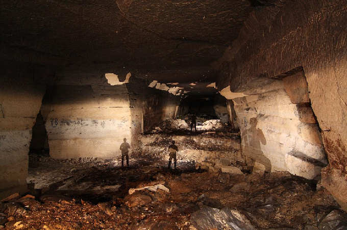Inside France's secret World War I bunker: Explorers find wartime weapons stowed away in underground quarry