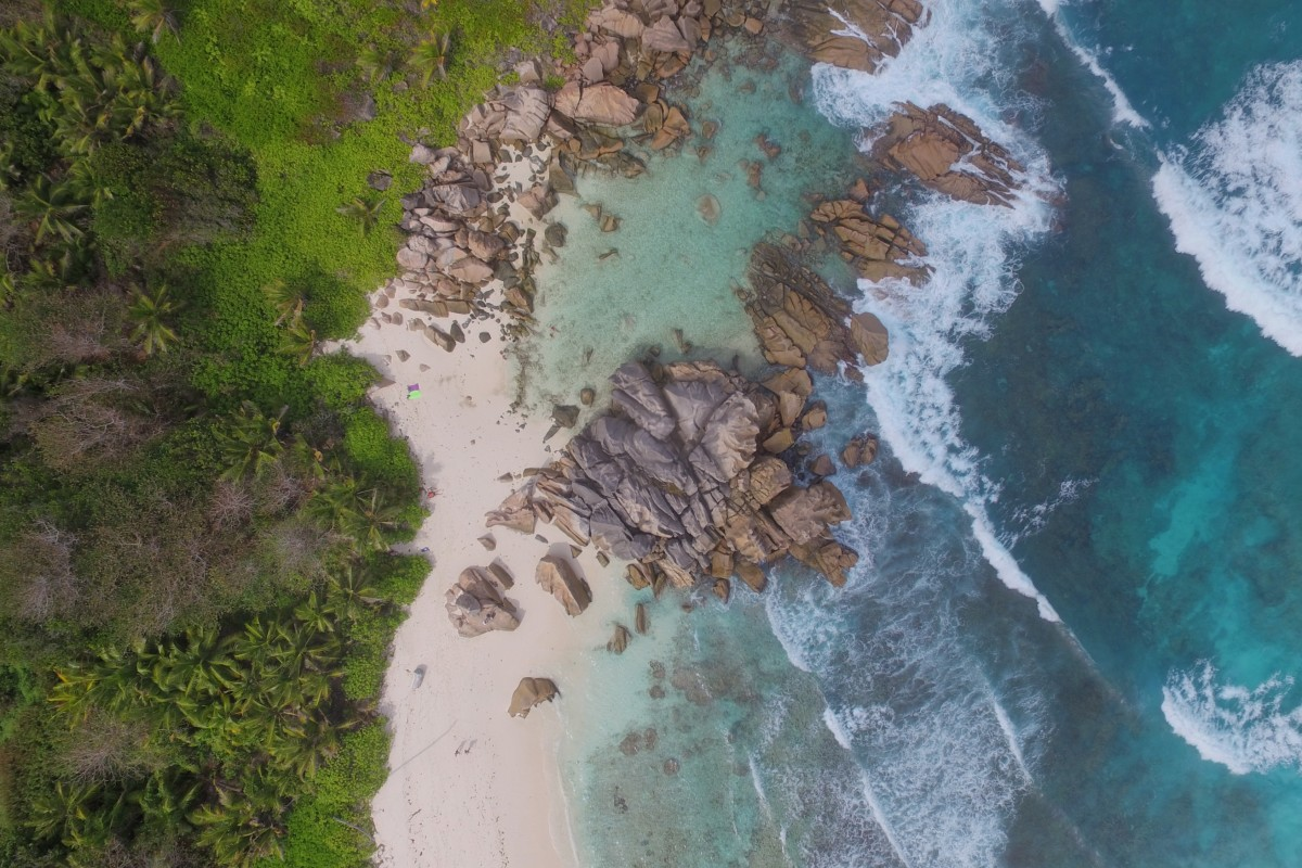 Waves hitting granite rocks