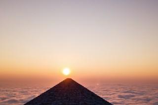 Pyramid in clouds desert
