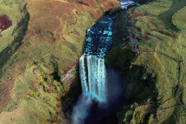 Take a look at the 62 meter strong Skogafoss.