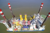 jack.-up vessel MPI Enterprise in Cuxhaven, taking off for NORDERGRÜNDE offshore wind farm with foundations