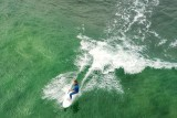Surfer catching a wave