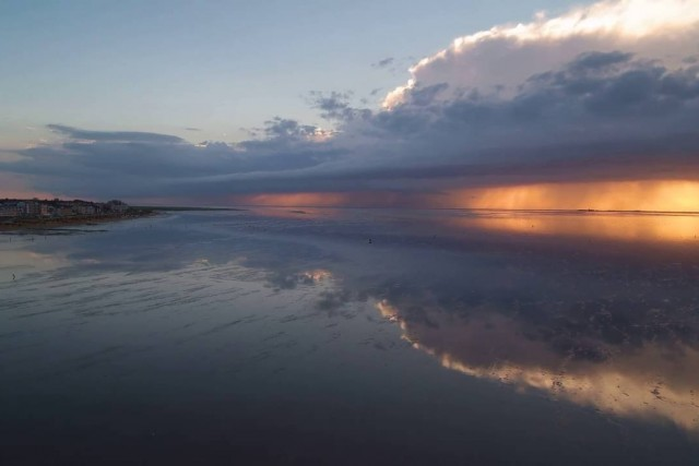 Sunset, Cuxhaven Germany, after a thunderstorm over Cuxhaven coast at low tide