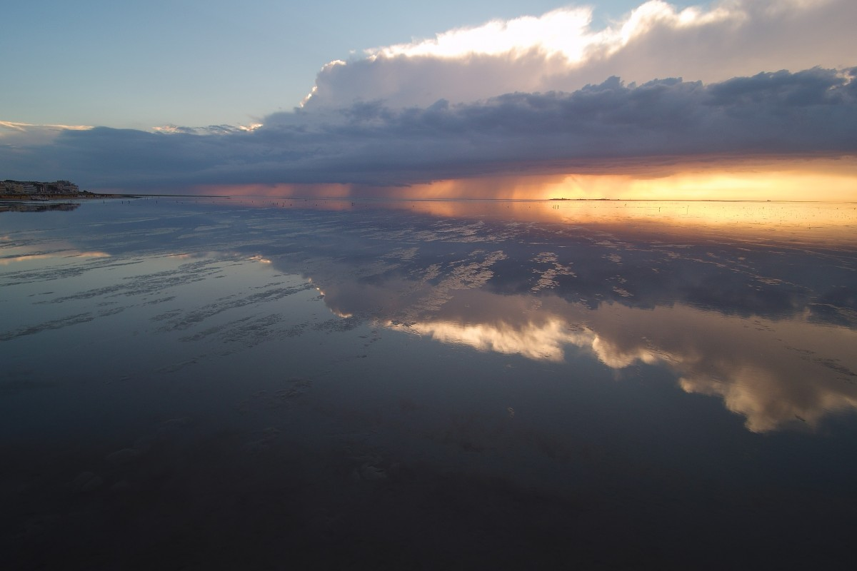 Cuxhaven sunset after a thunderstorm at low tide