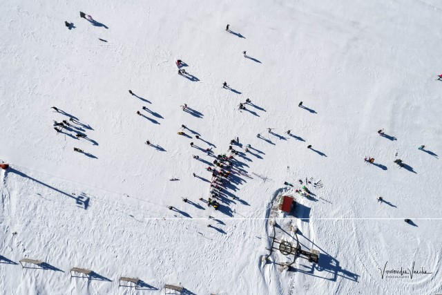 Aerial View of skiers at Ski Resort Vasilitsa in the mountain range of Pindos, in Greece.