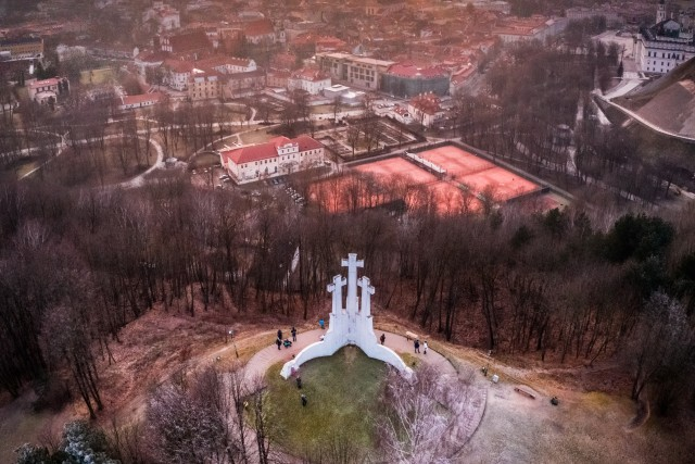 The capital of Lithuania is decorated with three white, magnificent crosses standing on a high mountain.