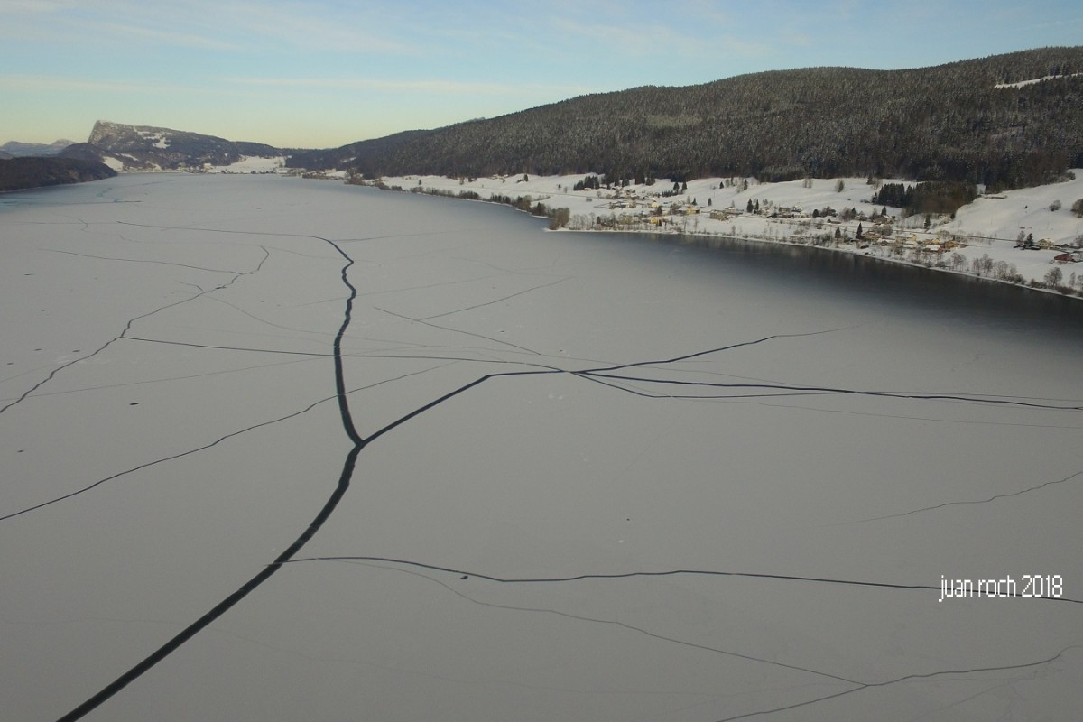 lakes and cracks in the partially frozen lake
