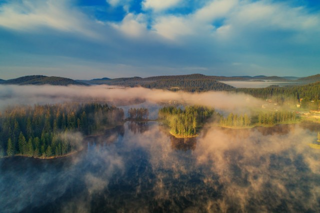 Aerial view of morning fog on the lake, sunrise shot.