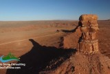 Aerial drone footage of butte and sandstone monument in Utah