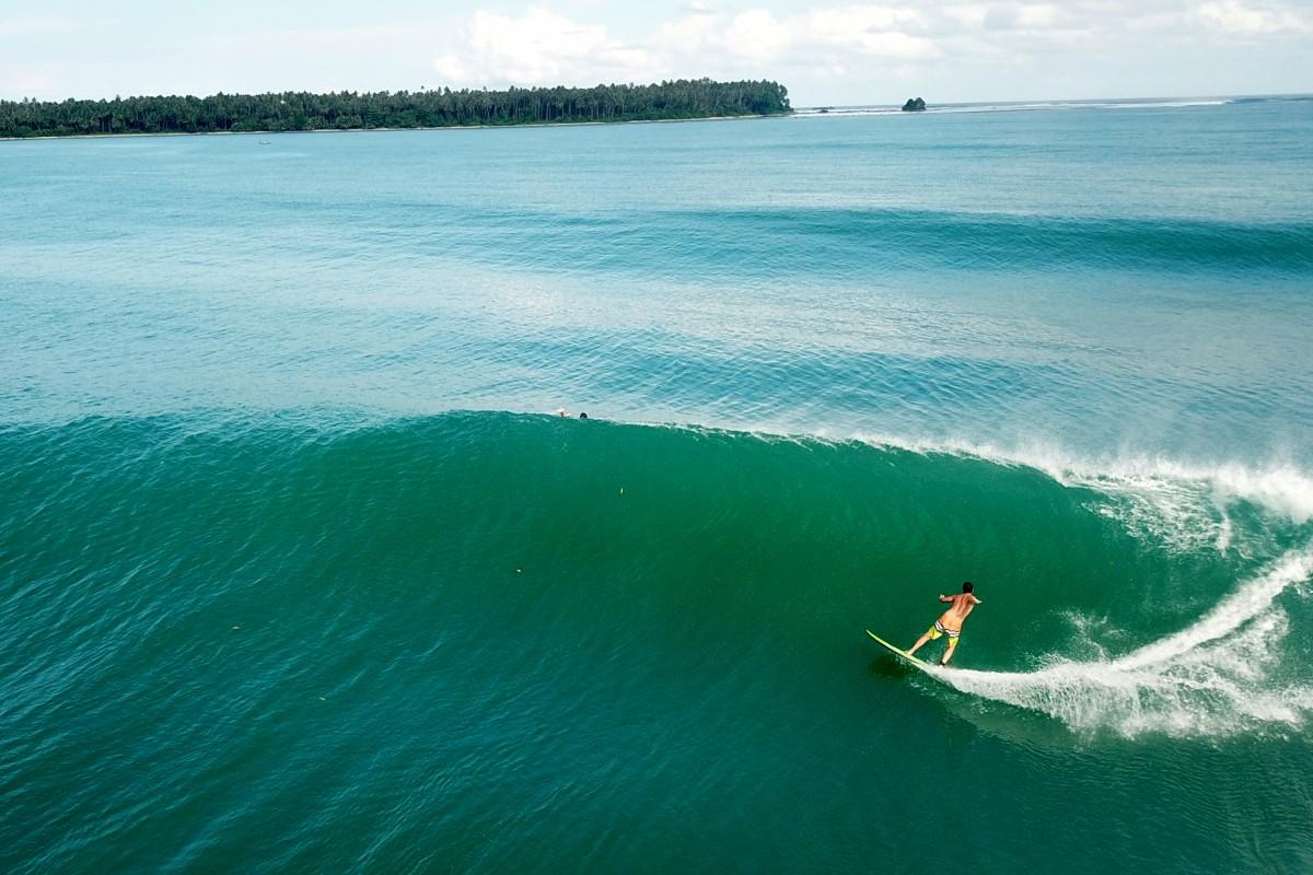Surfing in Sorake Beach
