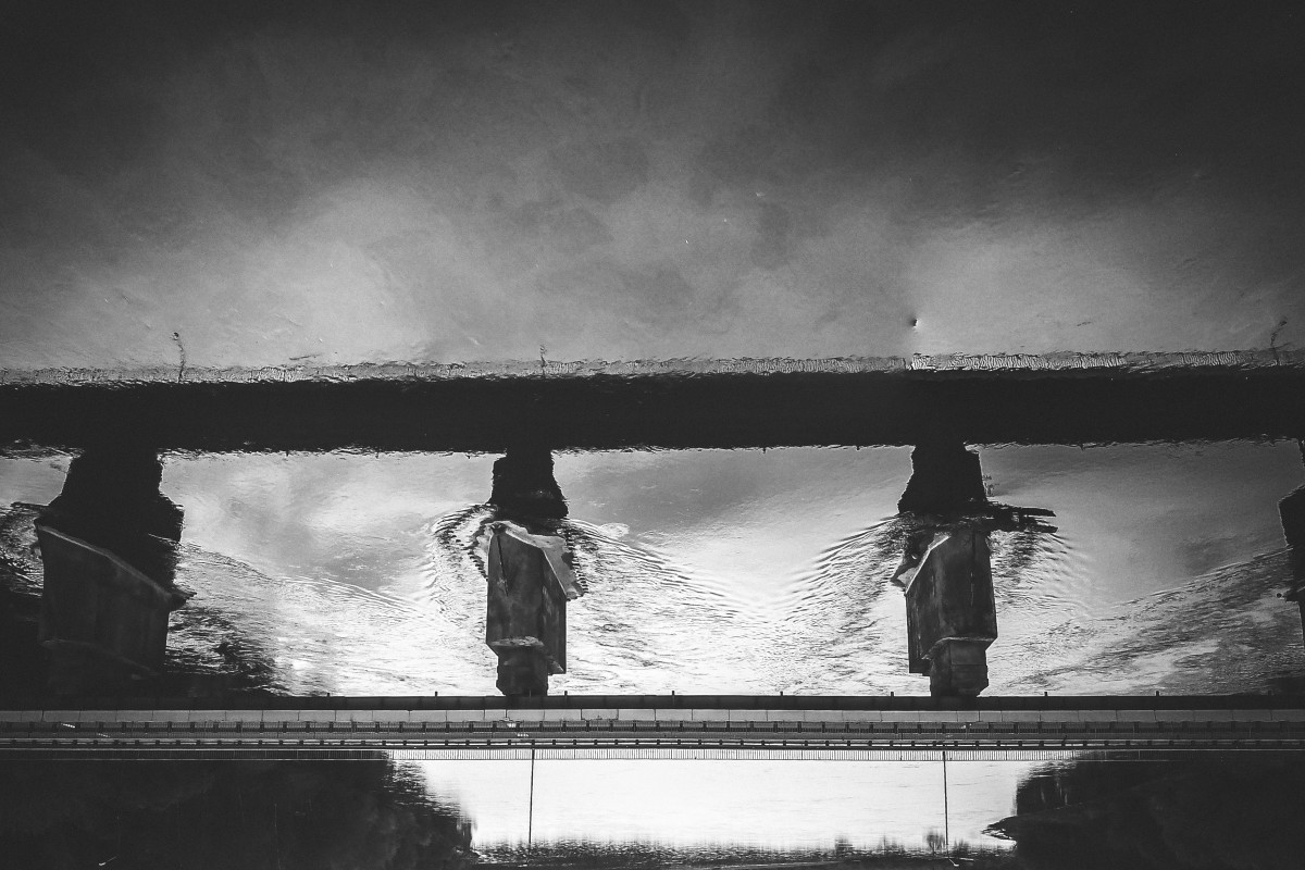 Upside down bridge over Nemunas/Neman river in Merkine, black and white