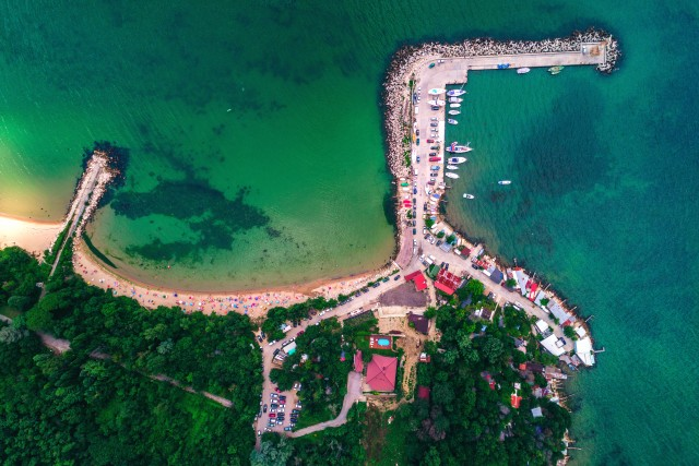 Aerial drone view of beautiful beach and fishing village.