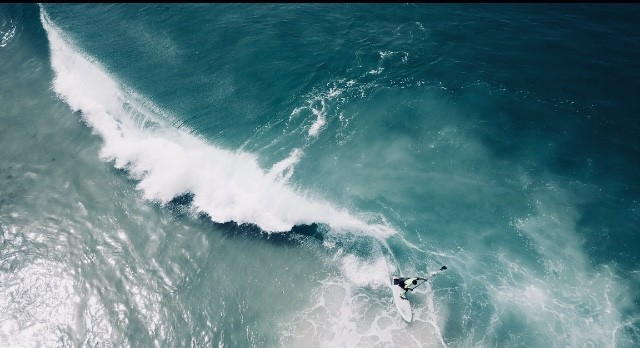 Incredible shot of a surfer by @dronefilmingbelgium