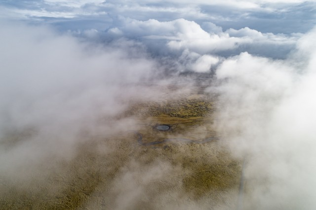 Small lake under the clouds