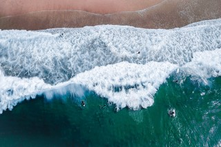 Surfers and waves by @dronefilmingbelgium