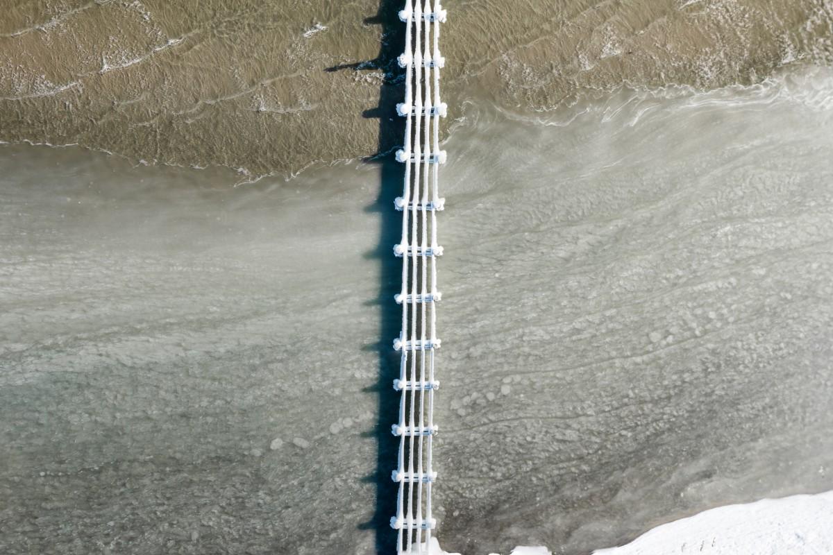 Lübeck Travemünde Frozen Jetty Aerial View in Winter HDR