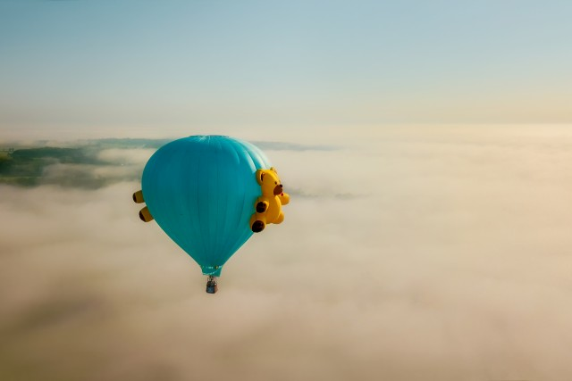 Blue Hot Air Balloon with Teddy in Flight over Fog 2
