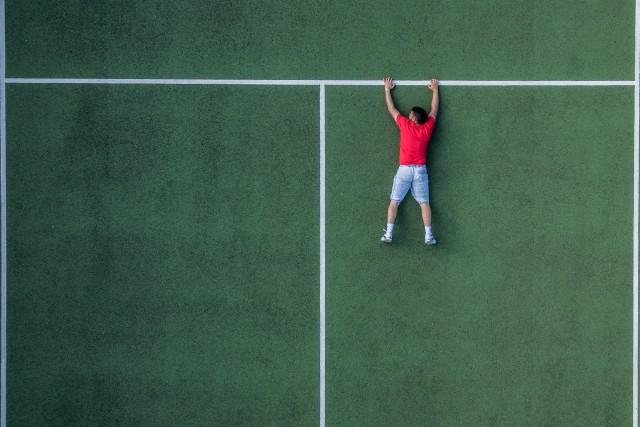 Hanging on tennis court
