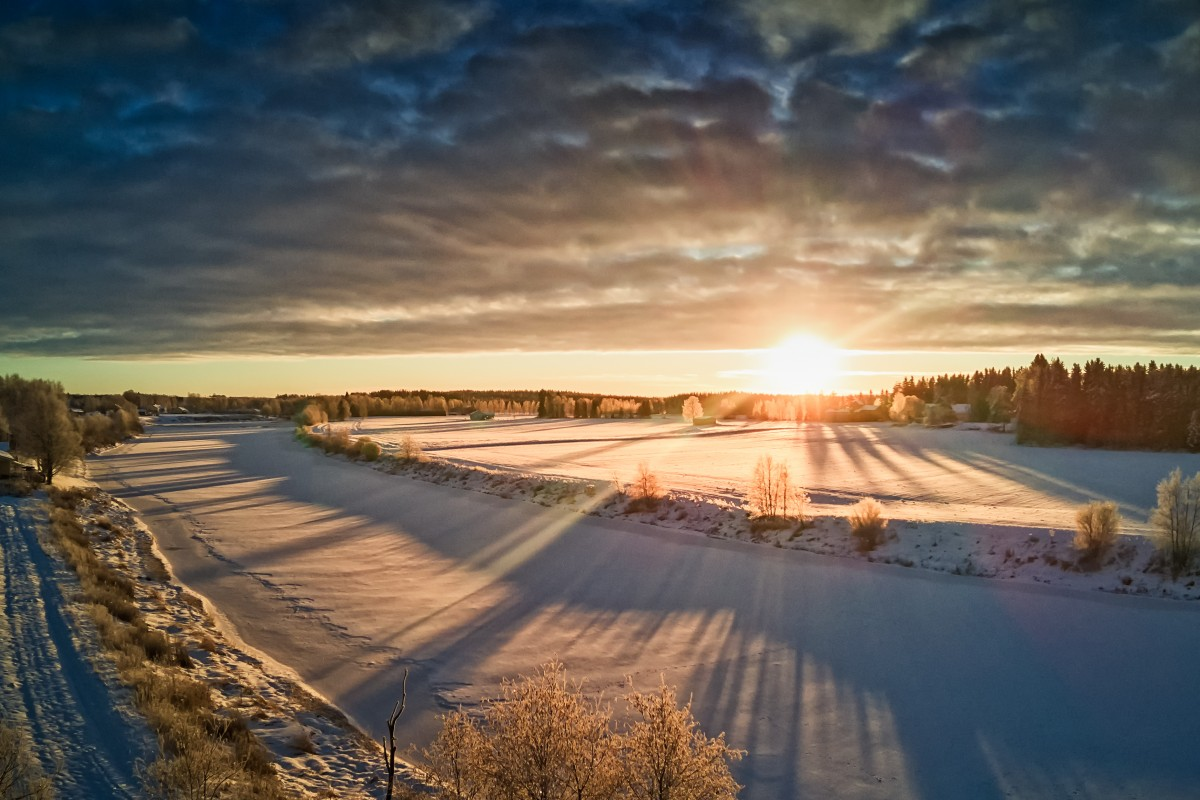 Sun Rising Over The Frozen River