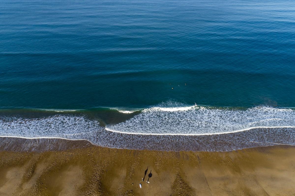 Surfers wait