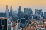Singapore's Downtown Skyscrapers and Chinatown roofs in one panorama.