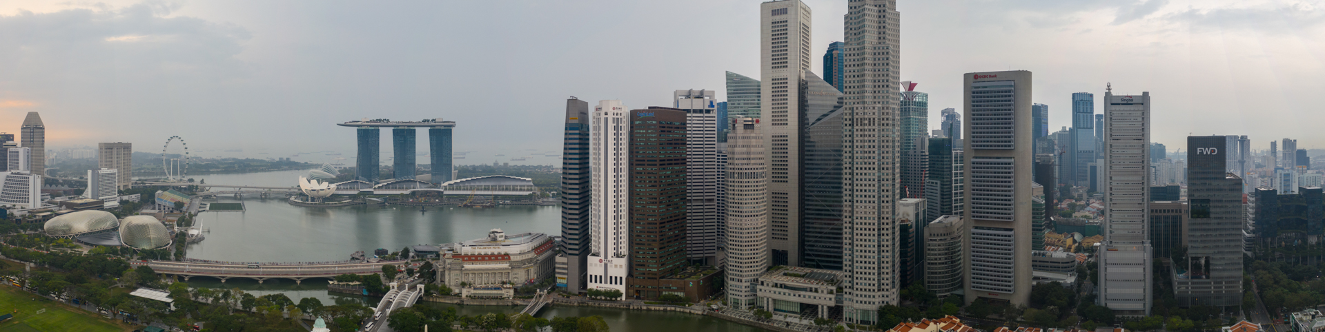 Singapore's Downtown Skyscrapers. Marina Bay Sands, Clarke Quay, Boat Quay in a panoramic shot.
