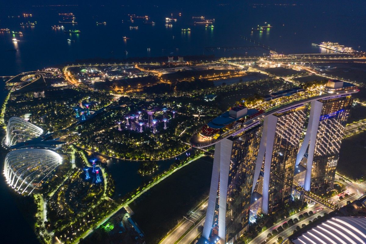 Night View of Gardens by The Bay, Marina Bay Sands and ships in Singapore Strait