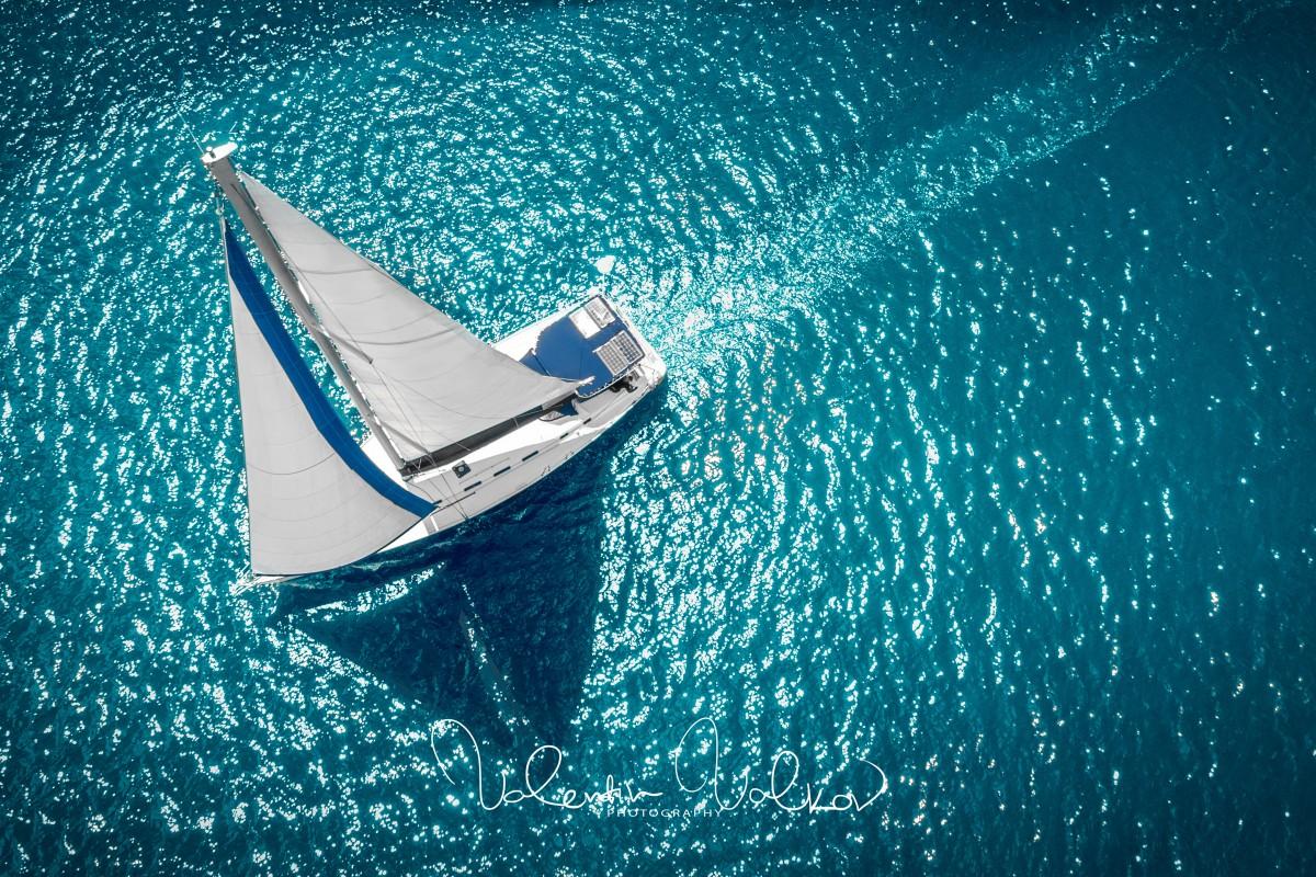 Regatta sailing ship yachts with white sails at opened sea.