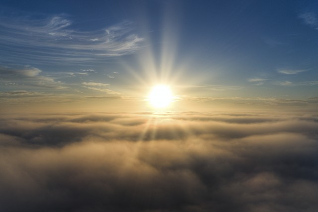 Sunrise Above the Fog and Clouds